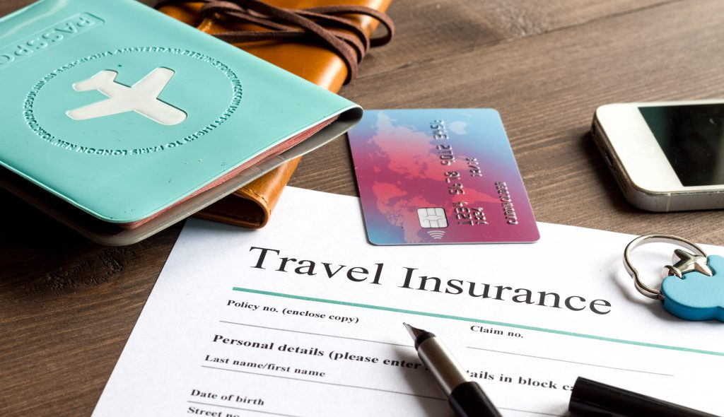 Photo of Travel Insurance Documents, Passport, and Credit Card